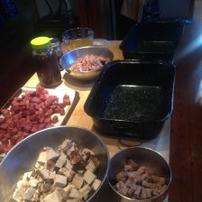 Here you see everything ready to put together, except the beans. They are on the stove. The duck, pork, sausage, juice from the duck and pork,  salt pork are ready to be layered together.